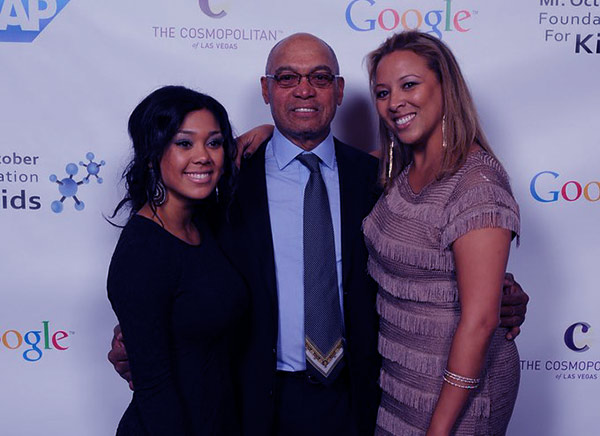 Image of Kimberly Jackson with father Reggie, and his Current partner at Mr. October Foundation for Kids Event